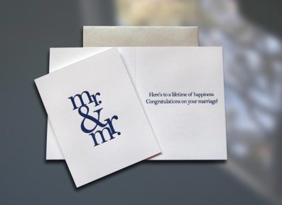 Single in sleeve luxurious letterpress wedding card. Inside reads: Here's to a lifetime of happiness. Congratulations on your marriage!  4.25 in x 5.5 in